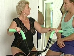 Horny granny bitch shamelessly takes gym trainer cock in mouth together with fucks him