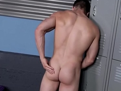 Powerfully built jock tugging his cock convenient the gym