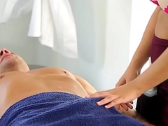 Busty doctor massages client with her mouth