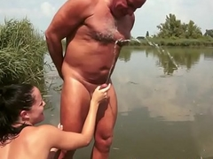 Euro babe pissing over grandpa
